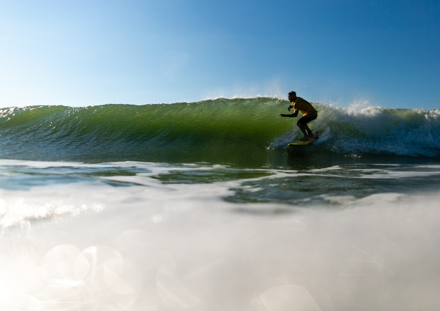 Jon Coen, content creator, riding crystal blue waves on Long Beach Island by Ryan Johnson