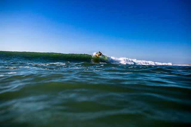 Jon Coen, content creator, riding crystal blue waves on Long Beach Island by Ryan Johnson Pandemic surfing